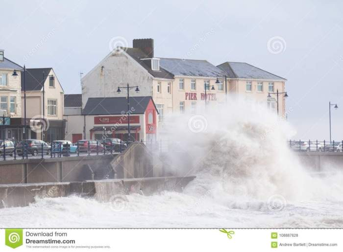 porthcawl-south-wales-uk-january-uk-weather-huge-waves-along-seafront-morning-as-stormy-weather-continues-stormy-seas-108887628